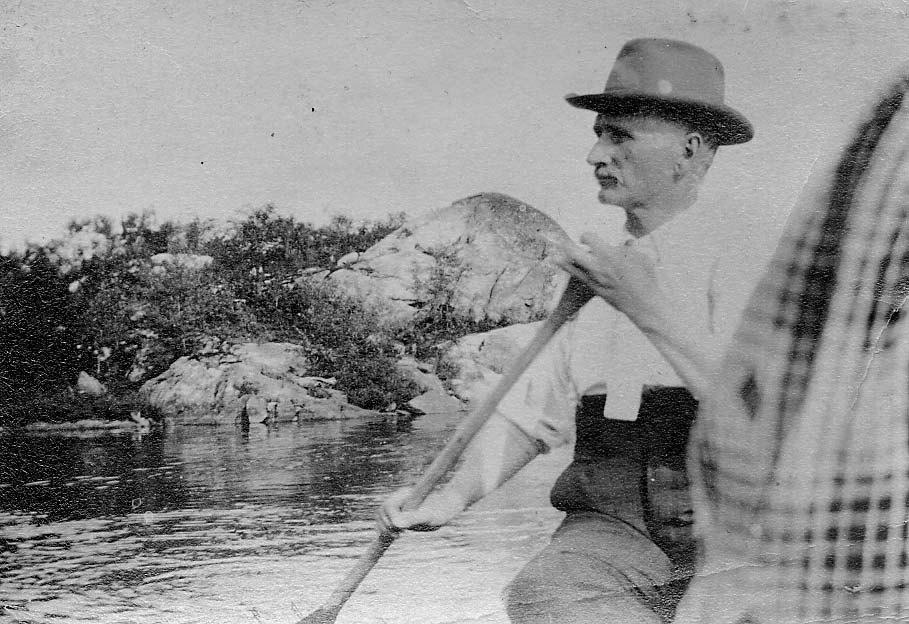 Hans Stevenson paddling in a canoe.